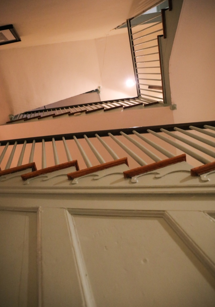 Floors and floors of winding stairs as seen from below inside the Peale Center.