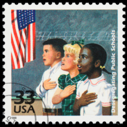 A .33 cent stamp, featuring an American flag, two white children, and an African American child. The text reads Desegregating Public Schools