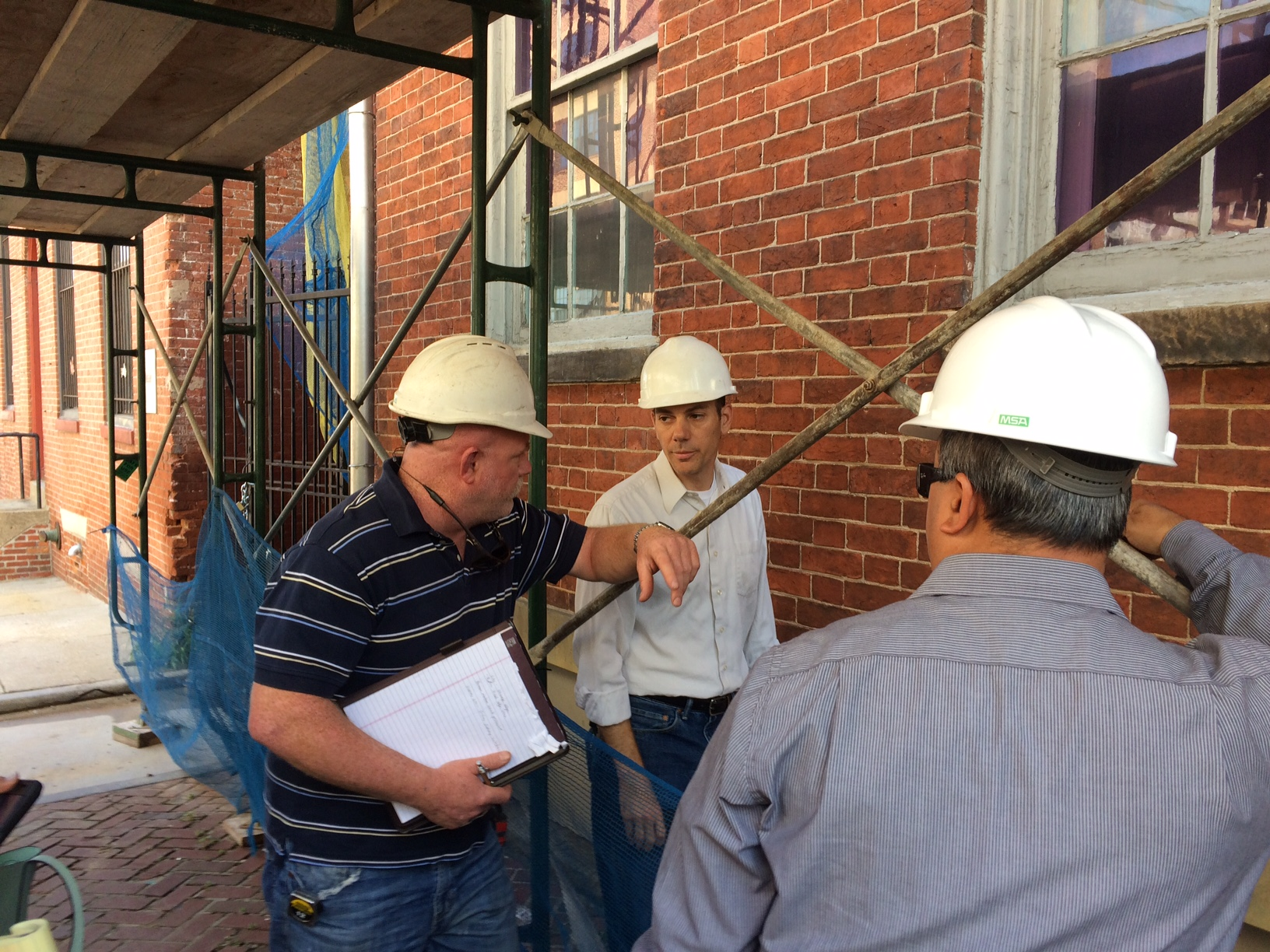 Ron Masotta, project architect, SM+P Architects, reviews the work with contractors and inspectors.